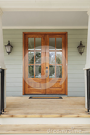 Free Twin Wooden Doors To A Green Family Home Royalty Free Stock Image - 42008676