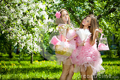 Twins in pink doll style