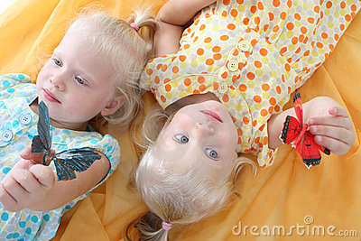 Twins playing with butterflies
