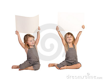 Twins in rompers holding blank paper sheets