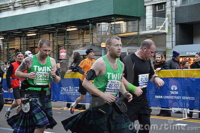 Twins running the Marathon Editorial Photo