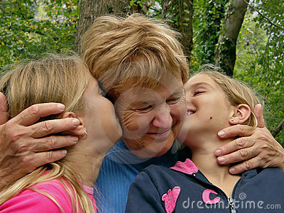 Twins, sister kiss a grandmother