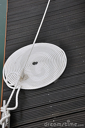 Twist rope of boat on dock board