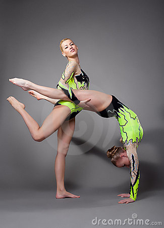 Two acrobats demonstrate skill