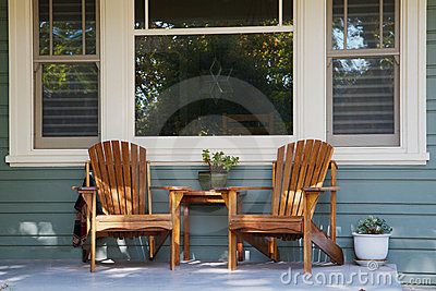 Two adirondack chairs porch