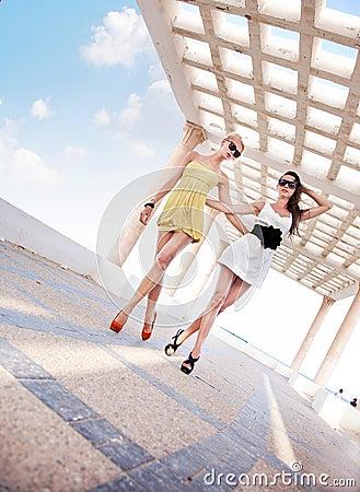 Two adorable women walking