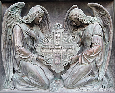 Two angels hold cross