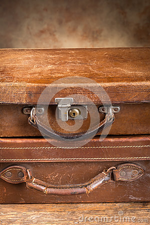 Two antique closed suitcases