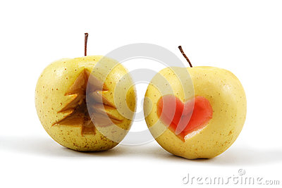 Two apples with cut Christmas tree and heart.