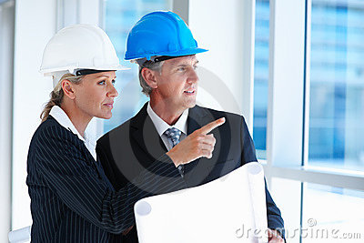 Two architects pointing while working together