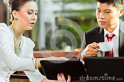 Two Asian Chinese business people