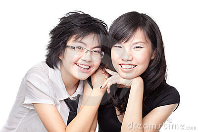 Two Asian Chinese girls sharing a bonding moment