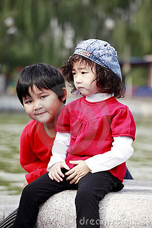 Two Asian little girl outdoors