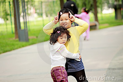 Two Asian little girls outdoor