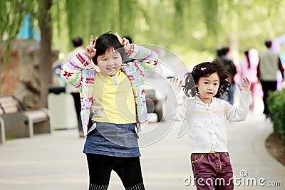 Two Asian little girls outdoor
