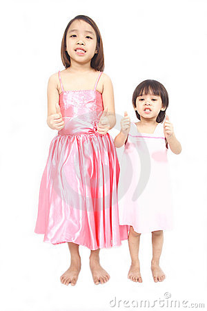 Two asian preschool girls holding thumbs up