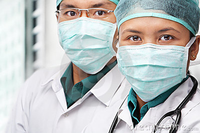 Two Asian surgeon posing to camera