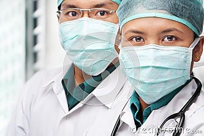 Two Asian surgeon posing to camera