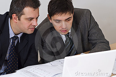 Two associates on a laptop