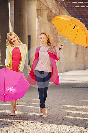 Free Two Attractive Girlfreinds With The Umbrellas Stock Photo - 38996300