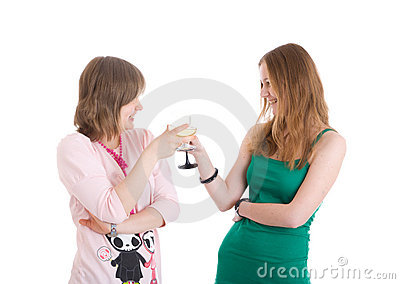 Two attractive girls with glasses of wine isolated