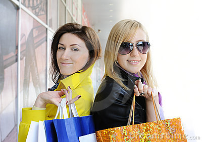 Two attractive girls out shopping