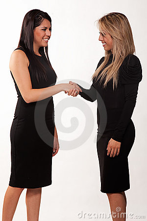 Two attractive hispanic twenties businesswomen