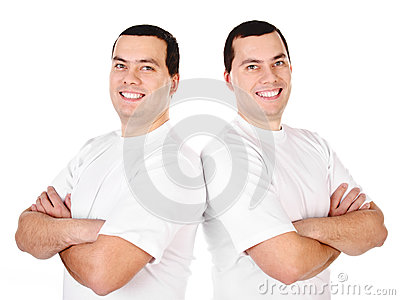 Two attractive positive smiling young men twins