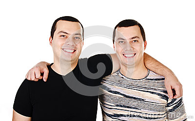 Two attractive positive smiling young men twins isolated