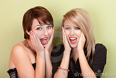 Two attractive teen girls screaming