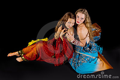 Two attractive woman look at you in indian costume