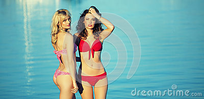 Two attractive women showing her beauty on the beach