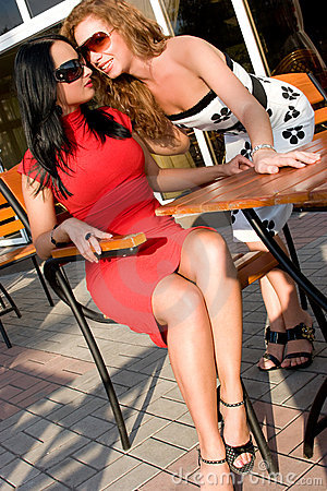 Two attractive women in street cafe