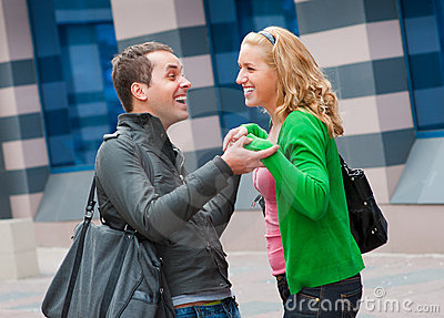 Two attractive young people met in the street