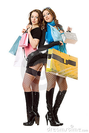 Two attractive young women after shopping