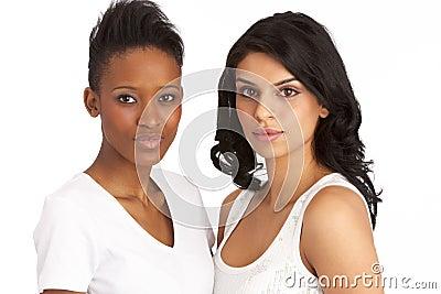 Two Attractive Young Women In Studio