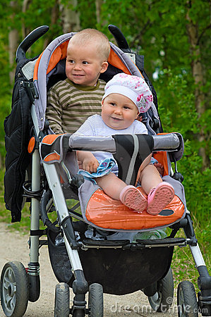 Two babies in children buggy