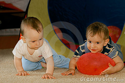 Two babies playing indoors