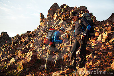 Two backpackers in morning mountains