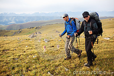 Two backpackers in mountains
