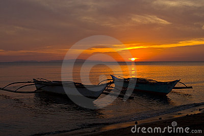 Two Banca Boats at Sunset on Beach