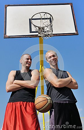 Two basketball players smiling
