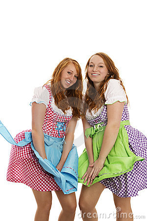 Two bavarian dressed girls fighting with wind