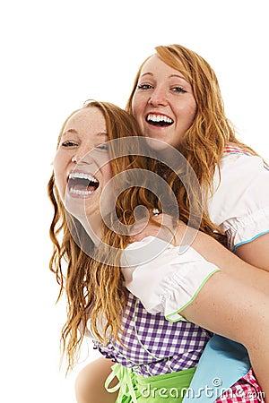 Two bavarian dressed girls having fun