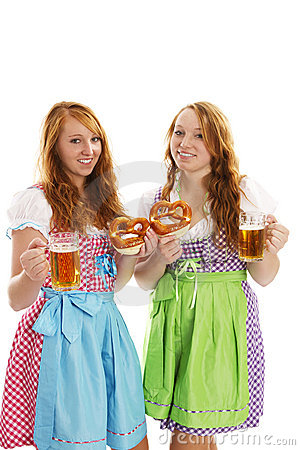 Two bavarian dressed girls with pretzels and beer