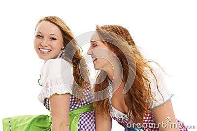 Two bavarian girls looking