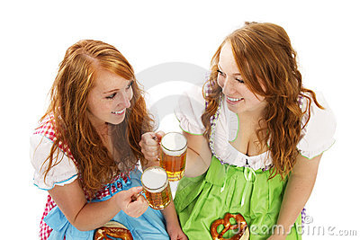Two bavarian women with beer and pretzels