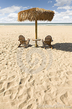 Two Beach Chairs and Umbrella on Beautiful Ocean Sand