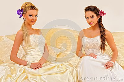 Two beautiful brides in a wedding dresses.