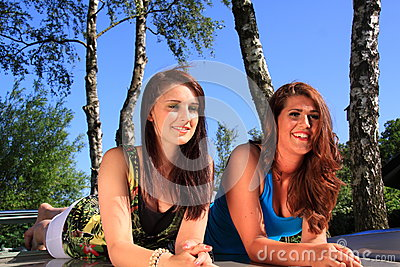Two beautiful brunette girls relaxing Editorial Image